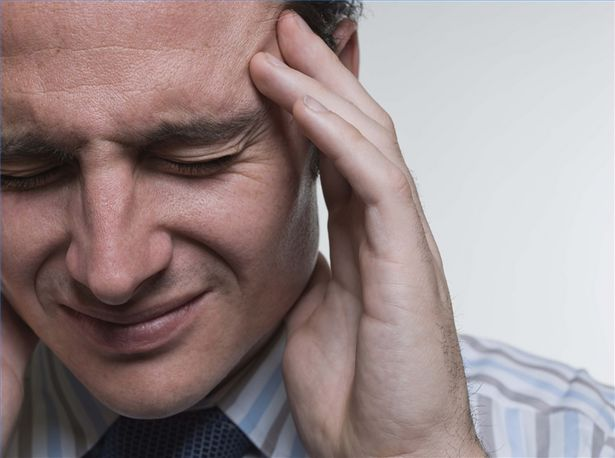 image of man with a headache